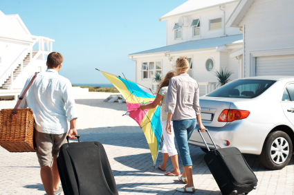 family arriving at holiday let