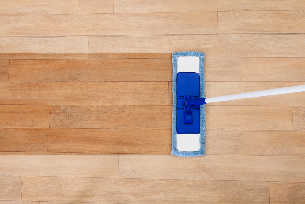 Mop cleaning a wooden floor