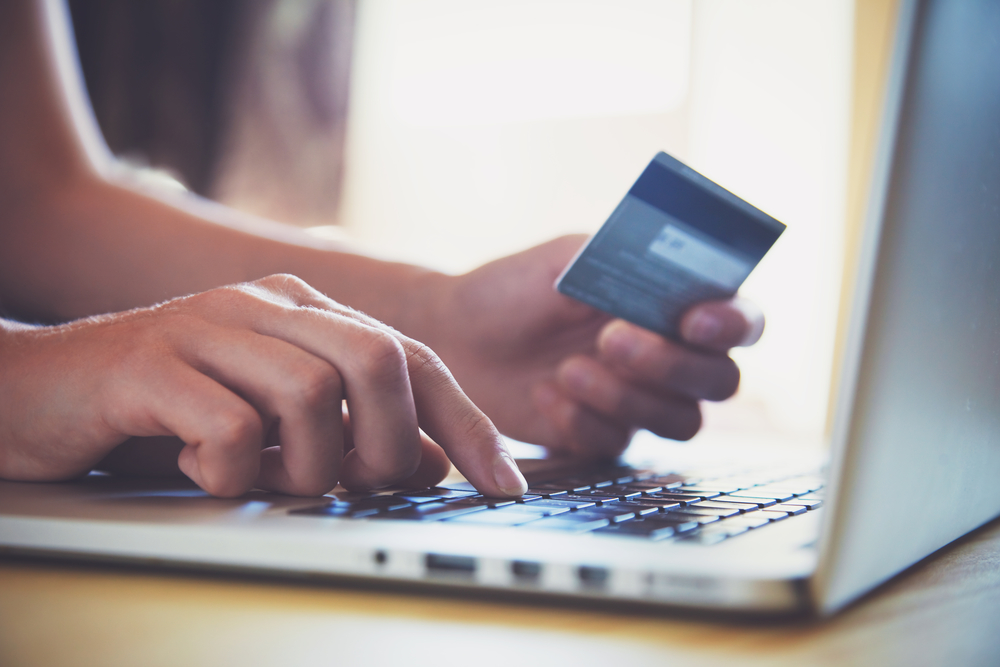 Woman adding payment card details to website