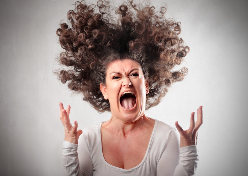 woman with curly hair screaming